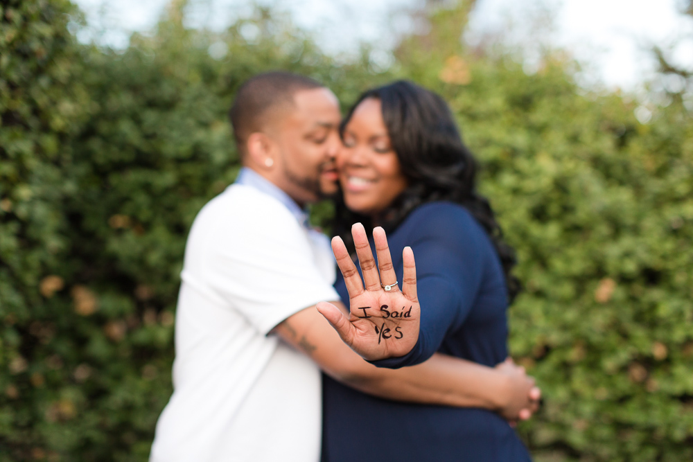 """I said yes"" on her hand with the engagement ring 