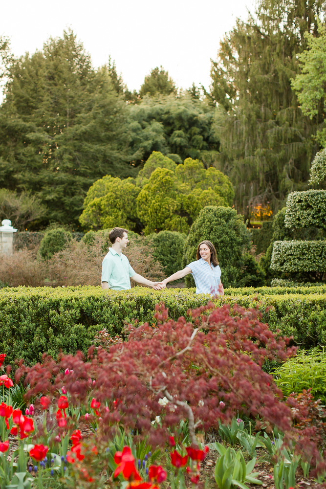 Holding hands while walking through the gardens