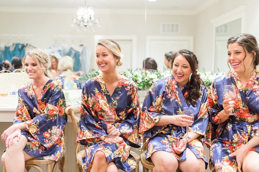 Laughing bridesmaids while getting ready for the wedding day | Charlottesville candid wedding photography | Megan Rei Photography