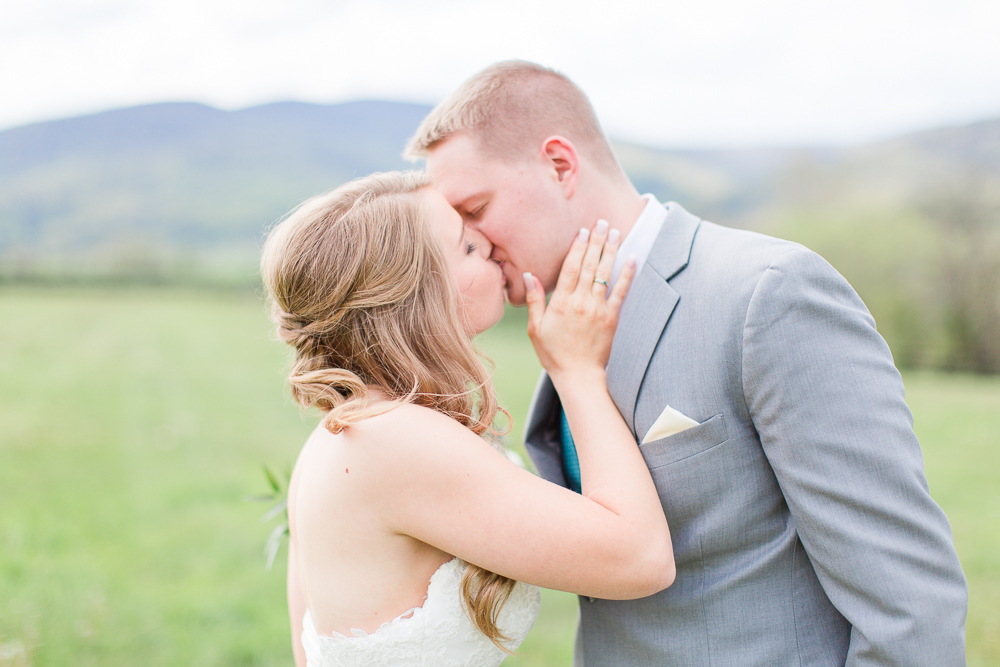 Candid photo of a kiss between the bride and groom | King Family Vineyards wedding | Virginia Winery Wedding Venue | Megan Rei Photography