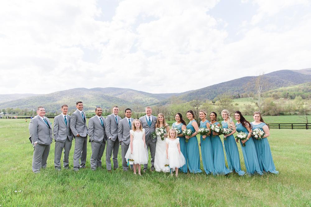 Wedding party photo with Blue Ridge Mountain views | King Family Vineyards wedding venue in Crozet, Virginia