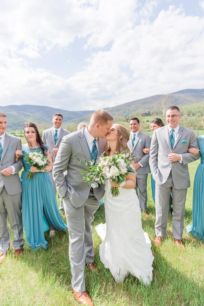 Bride and groom kiss at King Family Vineyards