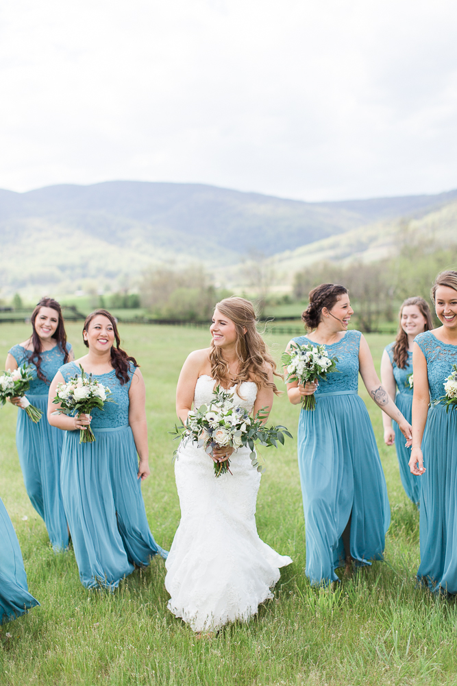 Bride and bridesmaids, with light blue dresses from David's Bridal | Candid Wedding Photographer in Crozet, Virginia | Megan Rei Photography | King Family Vineyards Wedding Photos