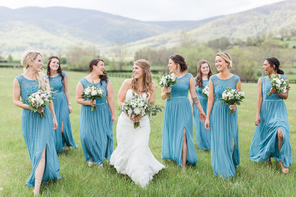 Bride and bridesmaids walking through the field at King Family Vineyards | Best Crozet Wedding Photographer | Best winery wedding venue in Virginia | Megan Rei Photography