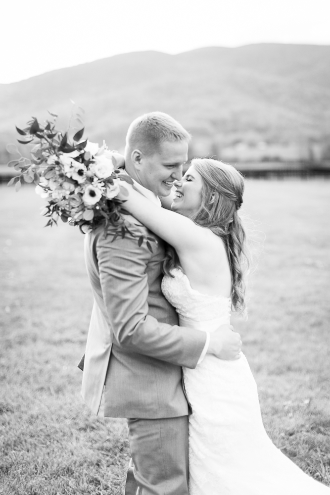 Candid wedding photographer in Crozet, Virginia | Laughing bride and groom at King Family Vineyards
