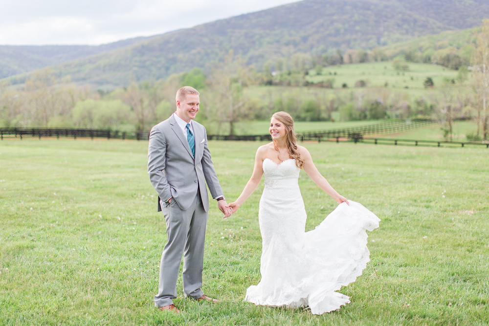 Happy wedding couple after their ceremony at King Family Vineyards | Crozet Virginia Wedding Photographer | Wedding dress from Ava Laurenne Bride