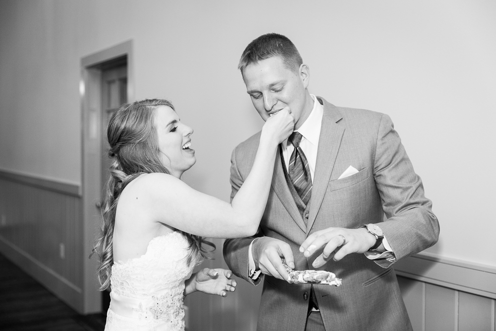 Bride and groom cutting the cake from Cakes by Rachel | Best Crozet Wedding Cakes