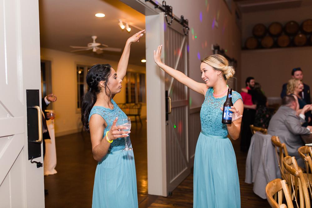 Bridesmaids dancing during the wedding reception in Crozet, VirginiaBridesmaids dancing during the wedding reception in Crozet, Virginia