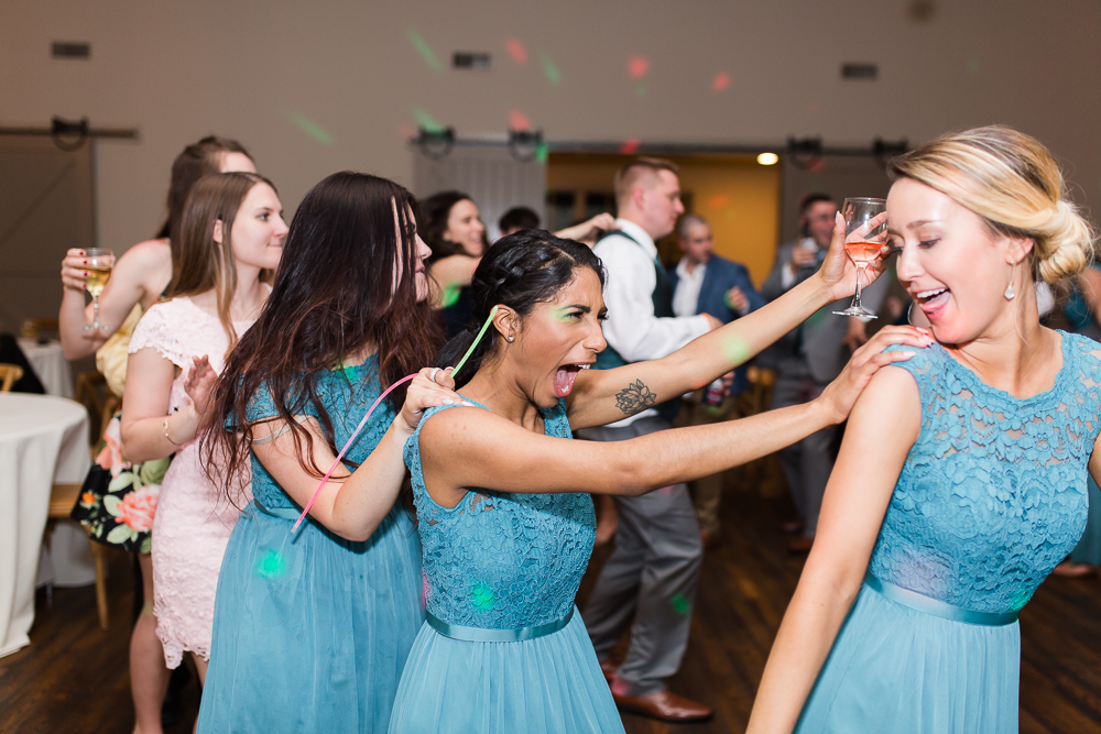 Bridesmaid having fun on the dance floor at King Family Vineyards | King Family Vineyards reception pictures