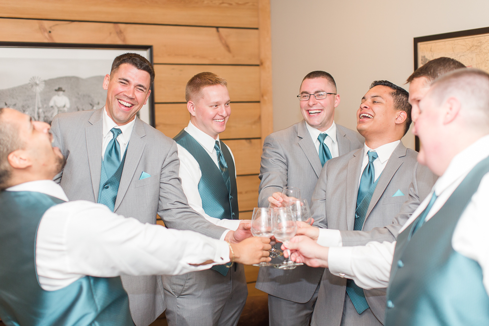 Groom and groomsmen hanging out on the wedding day
