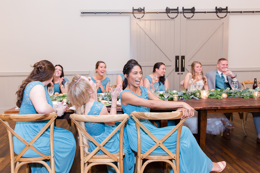 Wedding party laughter during the toasts