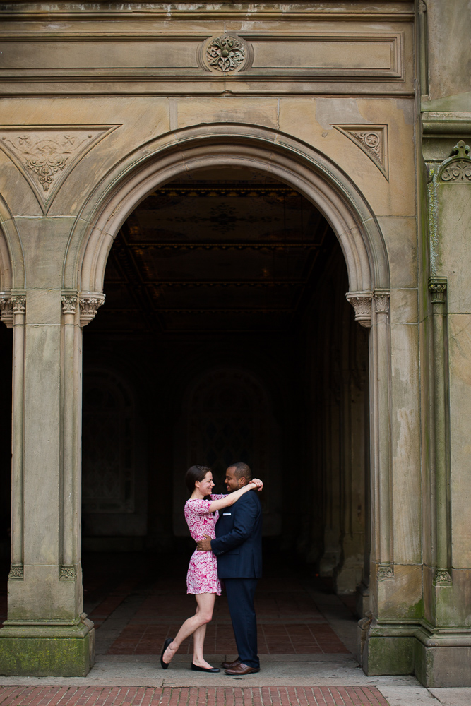 Engaged couple under the arches of the Bethesda Terrace| Central Park Engagement Pictures