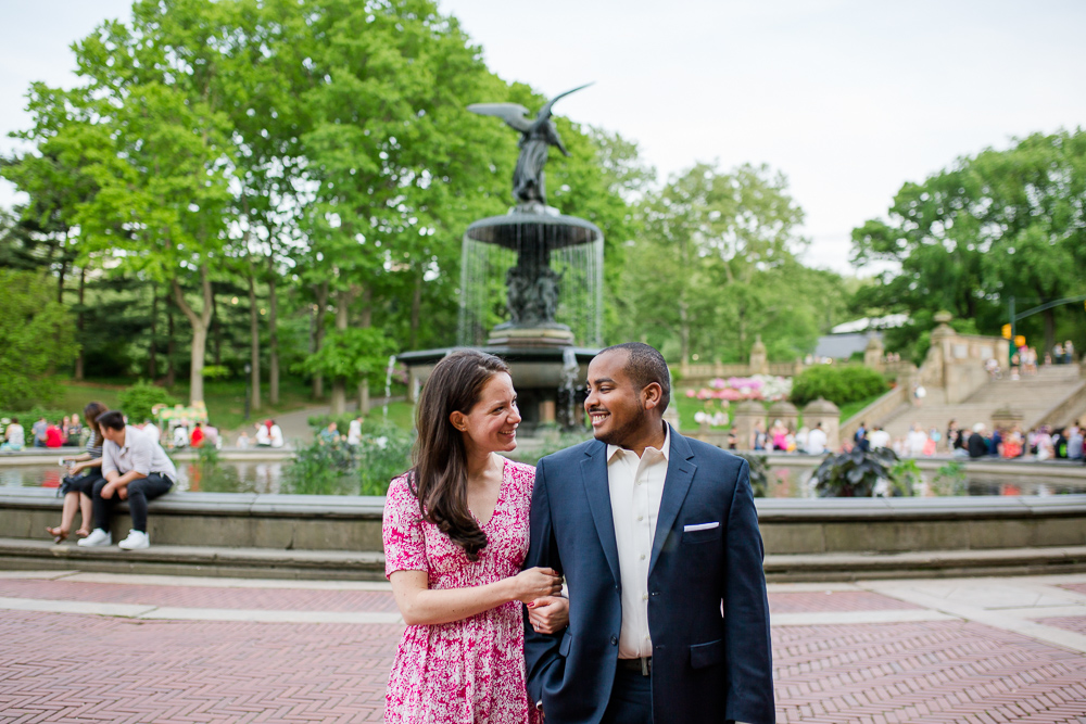 Candid engagement picture by the Bethesda Fountain | Places for engagement photos in Central Park, NYC