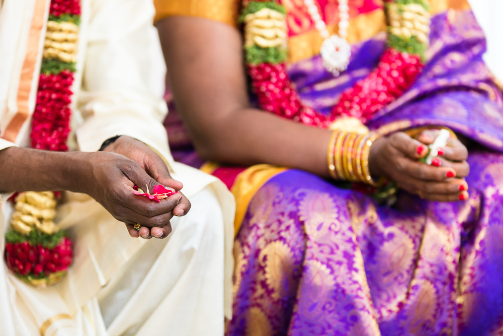 Husband and wife's hands during their Hindu vow renewal ceremony