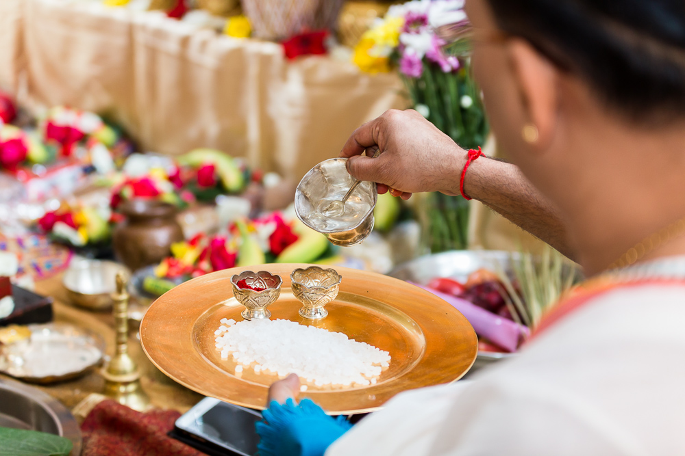 Priest pouring water during an Indian ceremony in Northern Virginia