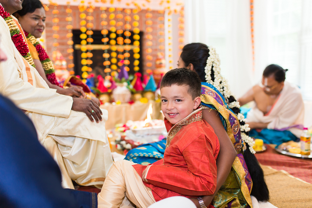 Couples' grandson smiling during the Shashti Poorthi