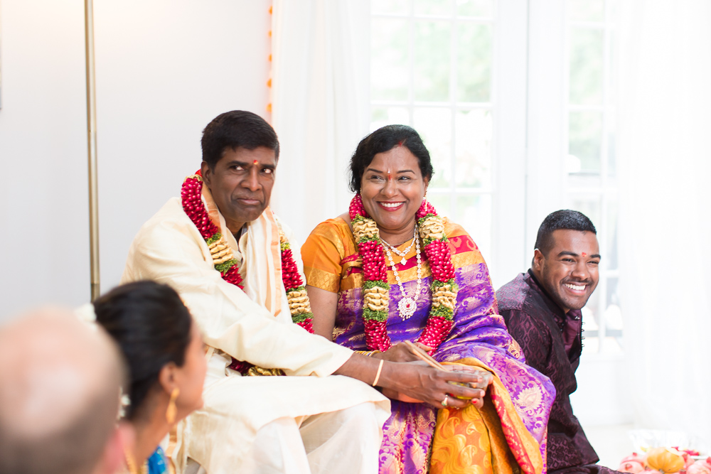 Candid picture of married couple and their son during the Hindu ceremony