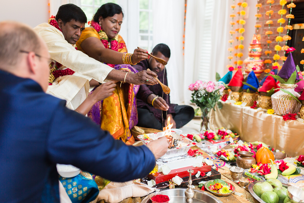 Fire and honey ritual during Indian marriage ceremony in Northern Virginia