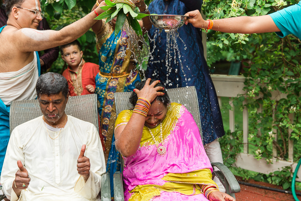 Water ritual during Shashti Poorthi | Northern Virginia Colorful Indian Wedding Photography