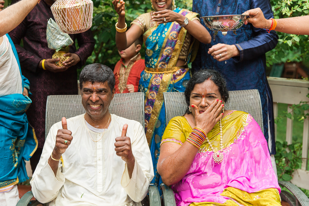 Fun photo of bride and groom after Indian water ritual during vow renewal in Northern Virginia | Megan Rei Photography