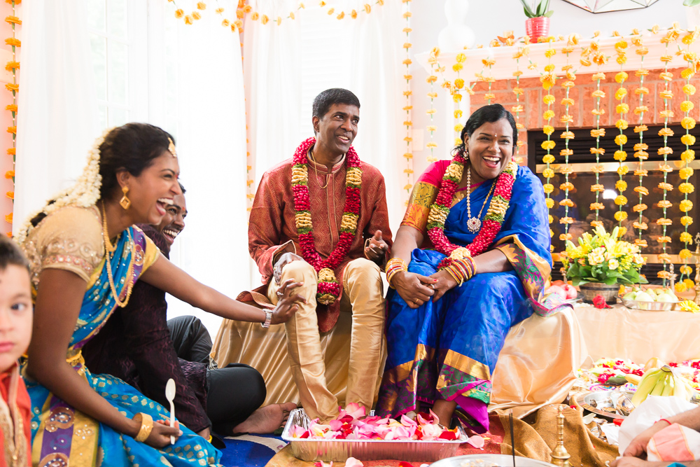 Candid laughter photo during Indian wedding vow renewal in DC