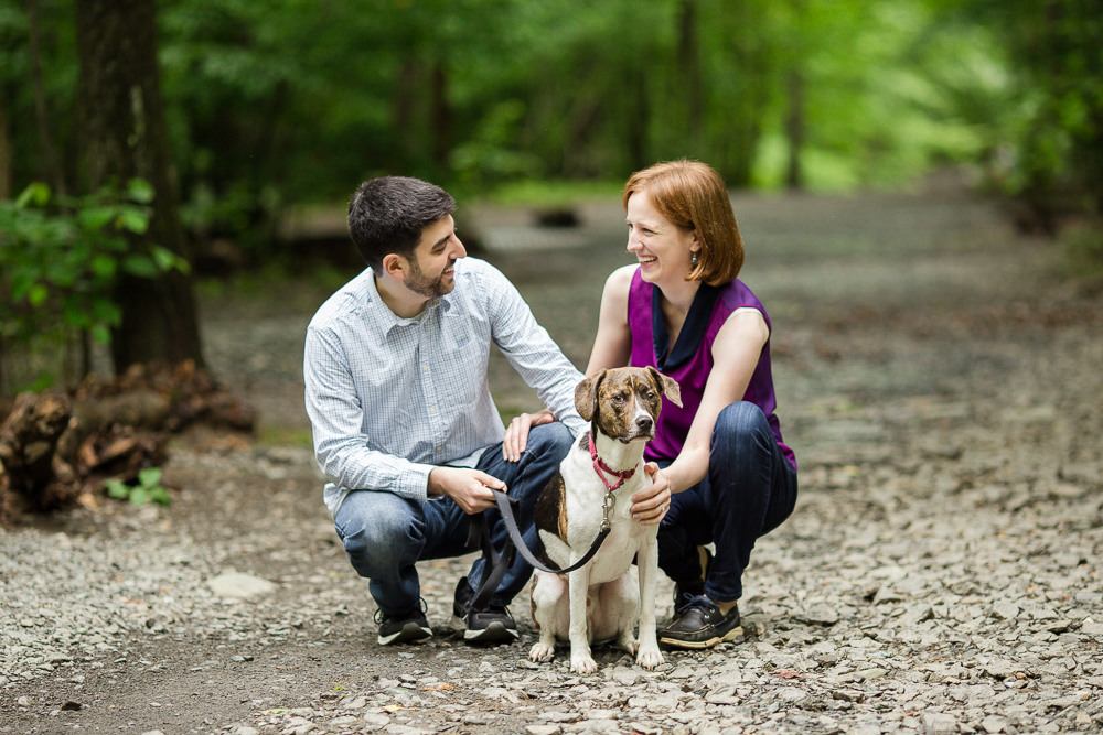 Candid engagement picture of couple hiking with their dog at Scott's Run Nature Preserve in Northern Virginia | Megan Rei Photgraphy