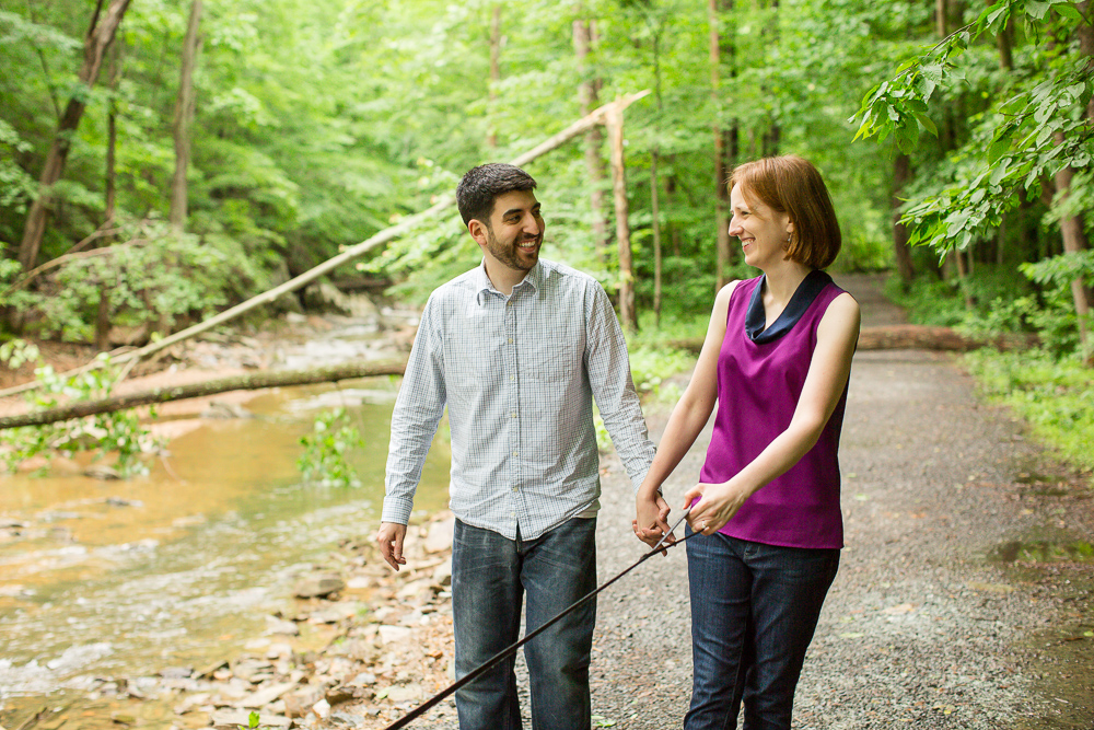Candid laughter photo as couple hikes along the trail at Scott's Run Nature Preserve