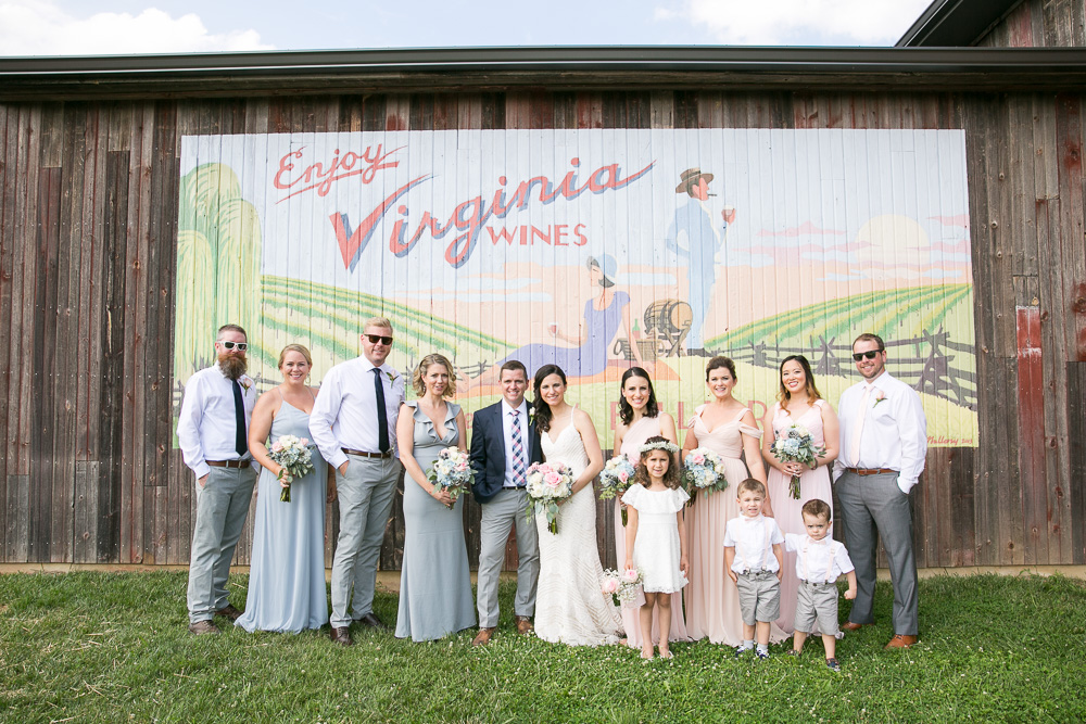 Wedding photography at the Winery at Bull Run in front of the Virginia wines mural | Summer winery wedding in Northern Virginia | Best winery wedding locations in Virginia
