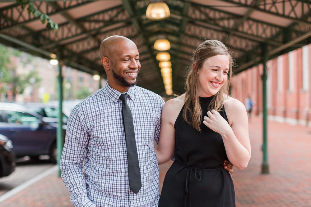 Laughing at Eastern Market during engagement photos | Washington DC engagement photographer
