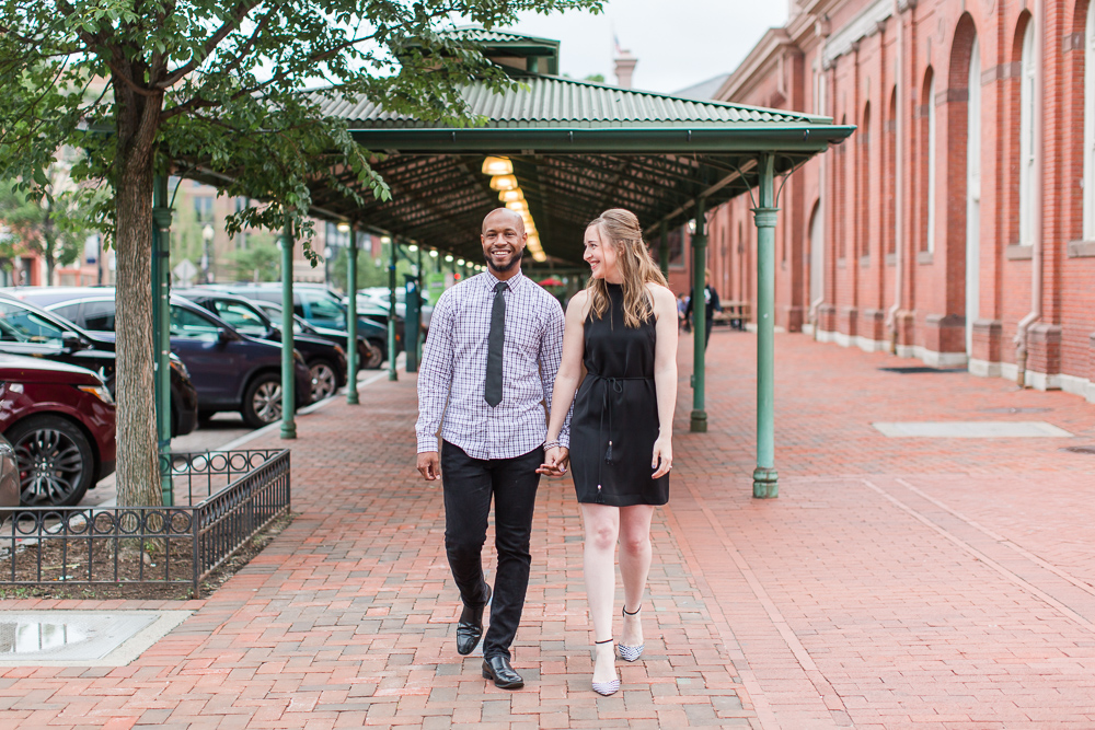 Engaged couple walking at Eastern Market, DC for their engagement session
