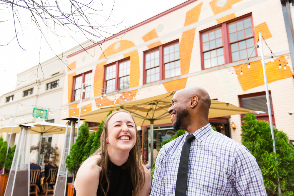 Candid laughter engagement picture at Eastern Market, DC
