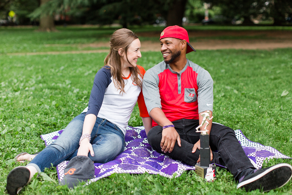 Sitting on a blanket during engagement pictures at Lincoln Park in Washington, DC