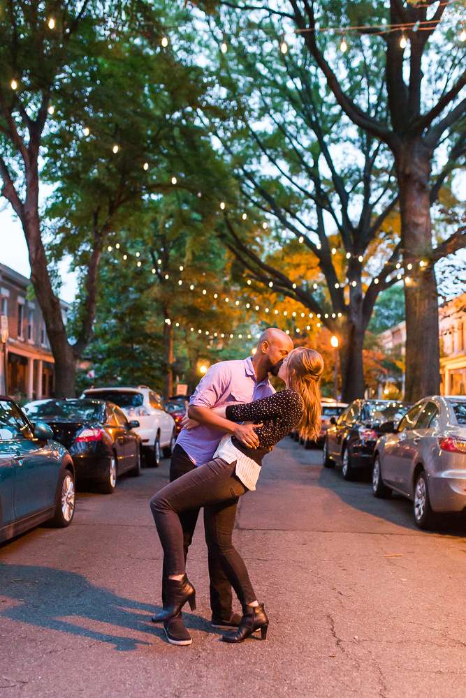 Kissing in the street under the string lights in Capitol Hill neighborhood of Washington DC