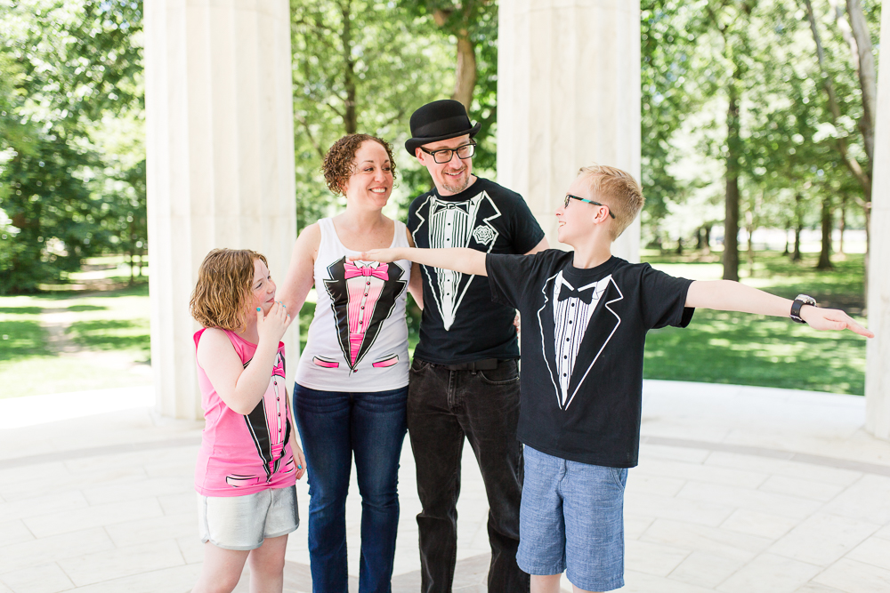 Fun family photo in their matching tuxedo t-shirts after the wedding ceremony