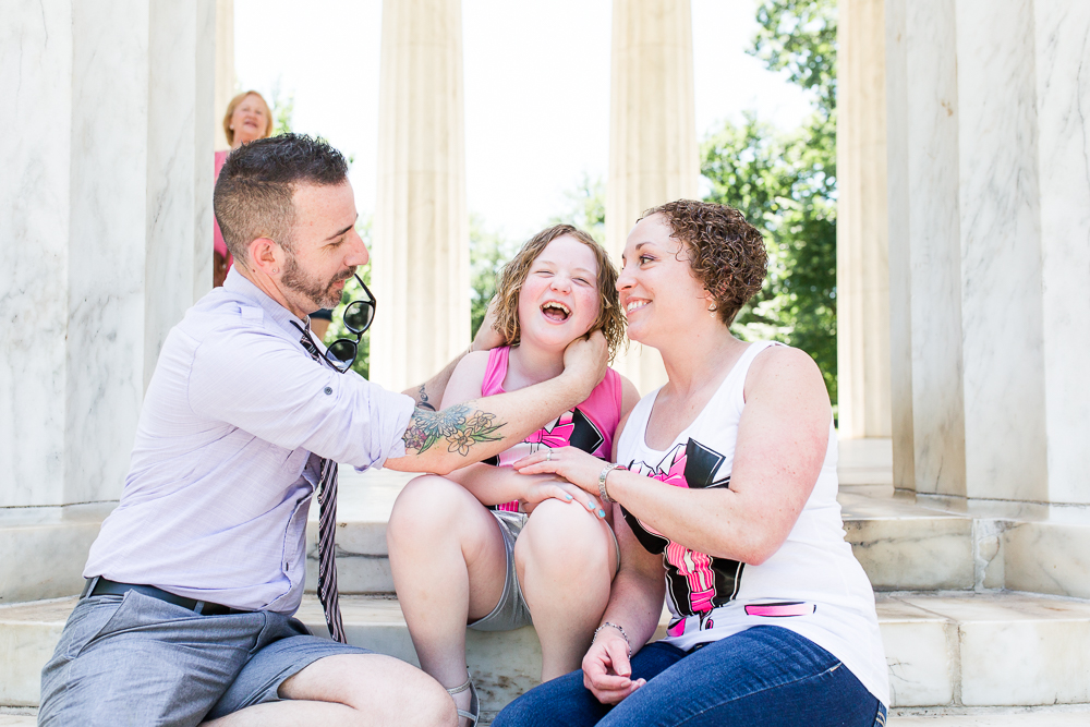 Making the bride's daughter laugh for some family photos on the steps of the DC War Memorial