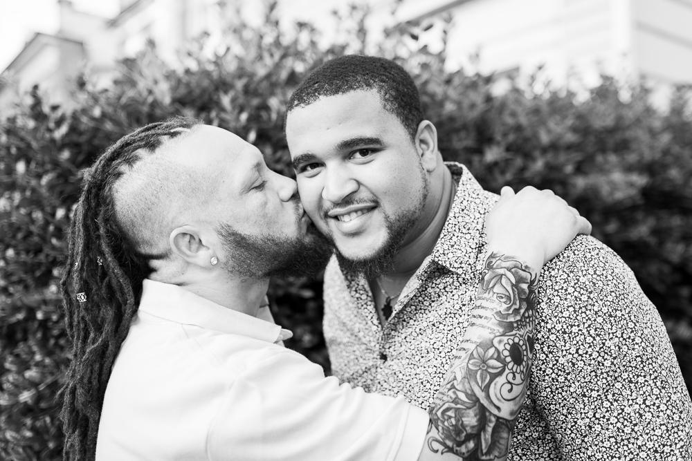 Giving his boyfriend a kiss on the cheek