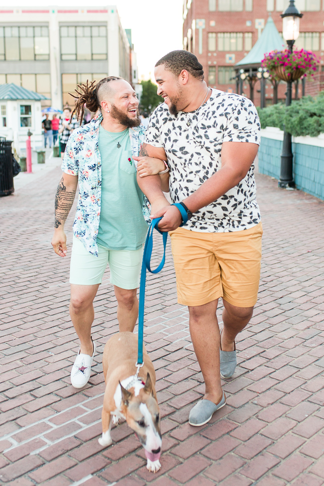Smiling gay couple with their dog during DC-area engagement session