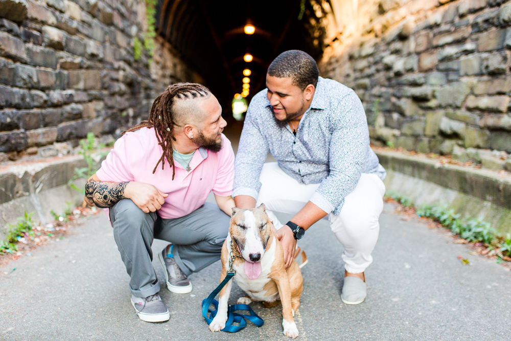 Dog dads with their bull terrier near the Wilkes Street Tunnel in Alexandria, Virginia