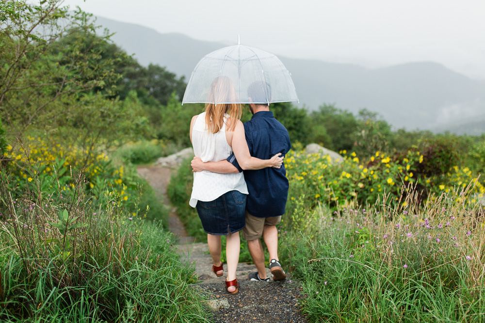 Cuddling under an umbrella on the trail in Shenandoah | Luray Photographer