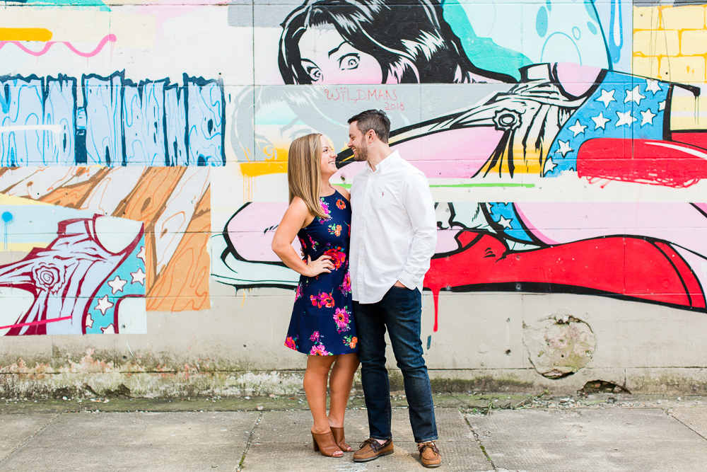 Engaged couple by the murals in Richmond, Virginia
