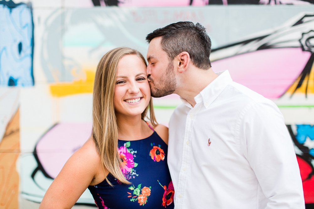 A kiss on the cheek from her fiance during a Richmond, VA engagement shoot