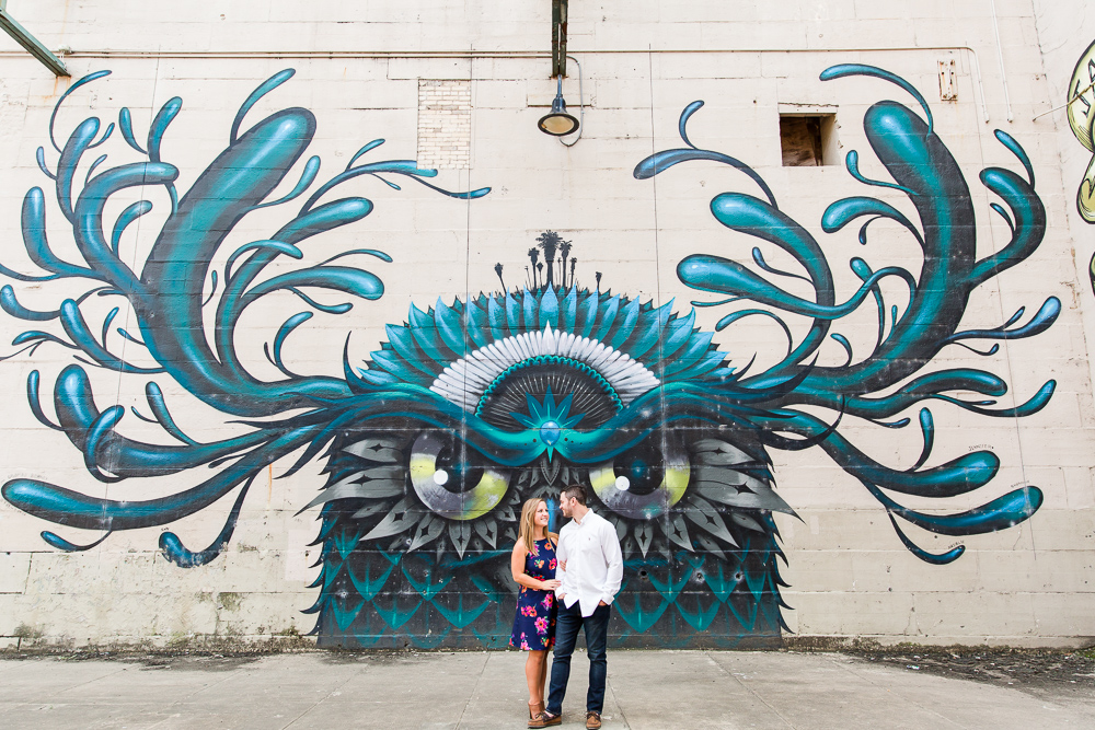 Engagement picture by the giant owl mural on the Richmond Canal Walk | Richmond Virginia engagement photographer