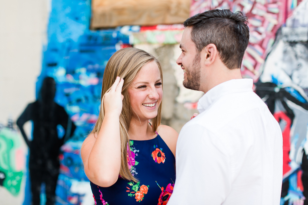 Sweet bride-to-be laughing with her fiance during their Richmond engagement session