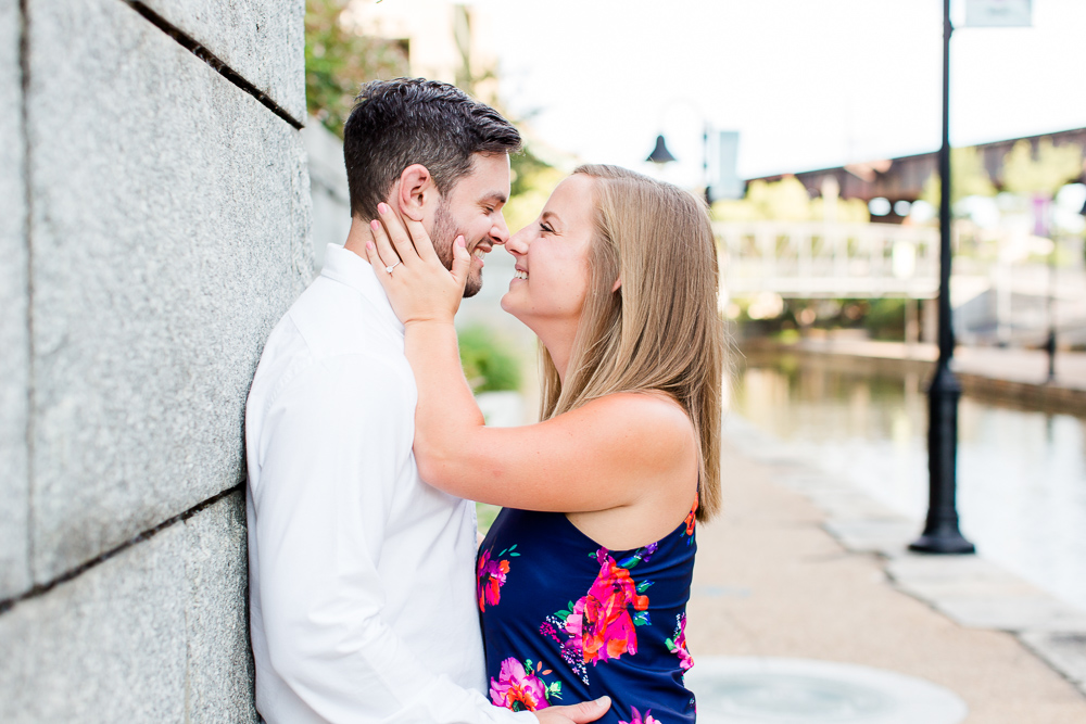 Engaged couple leaning in for a kiss along the canal in Richmond, Virginia | RVA Engagement Photo Locations