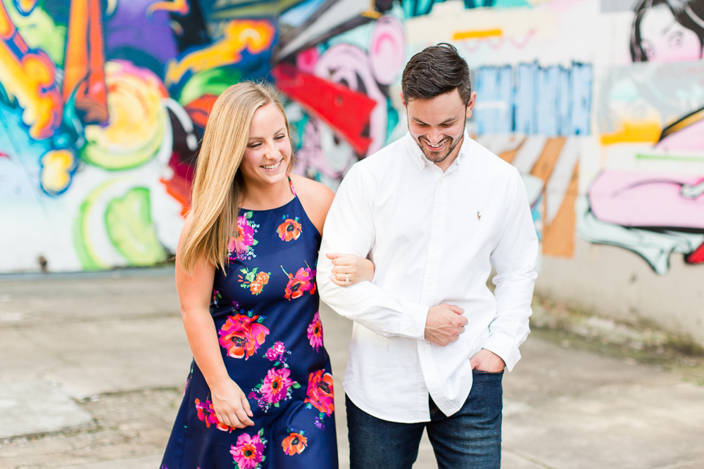 Candid engagement photography in Richmond, Virginia | Canal Walk Street Art