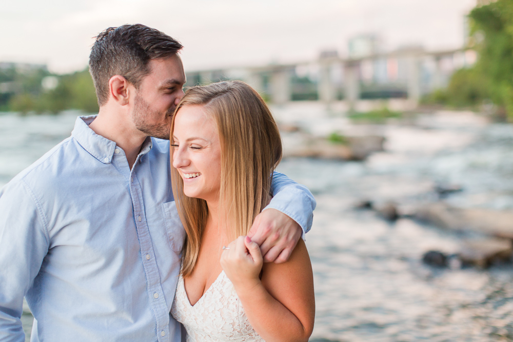 Engaged couple kisses on the Belle Isle rocks | James River engagement pictures