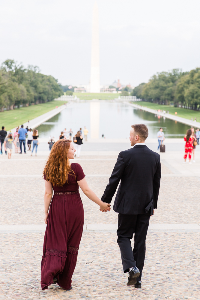 Engagement picture walking towards the Reflecting Pool | Megan Rei Photography | DC Engagement photographer