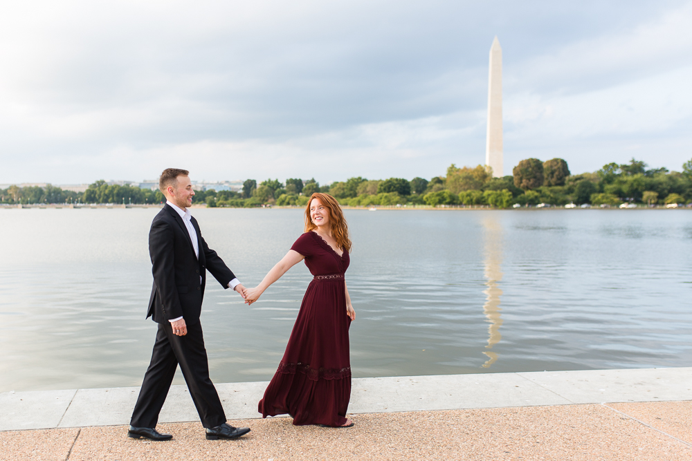 Walking hand-in-hand along the Tidal Basin with Washington Monument in the background