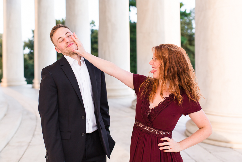Fun couple goofing around in the Jefferson Memorial