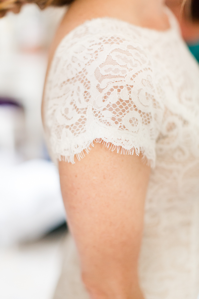 Lace details on bride's wedding dress